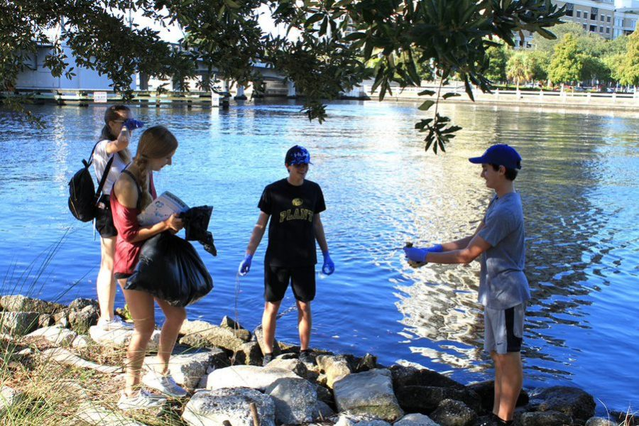 To prevent waste from getting into the river, students pick up trash along the Riverwalk during the Hillsborough river and coastal cleanup Sept 21. The students kept a log of all the trash picked up to document the total waste collected at the event.