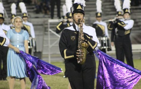 Instrument in front of her, junior Hannah Mongoy competes at Braden River High School with the rest of the marching band. Mongoy has been a part of the band program for the past three years.