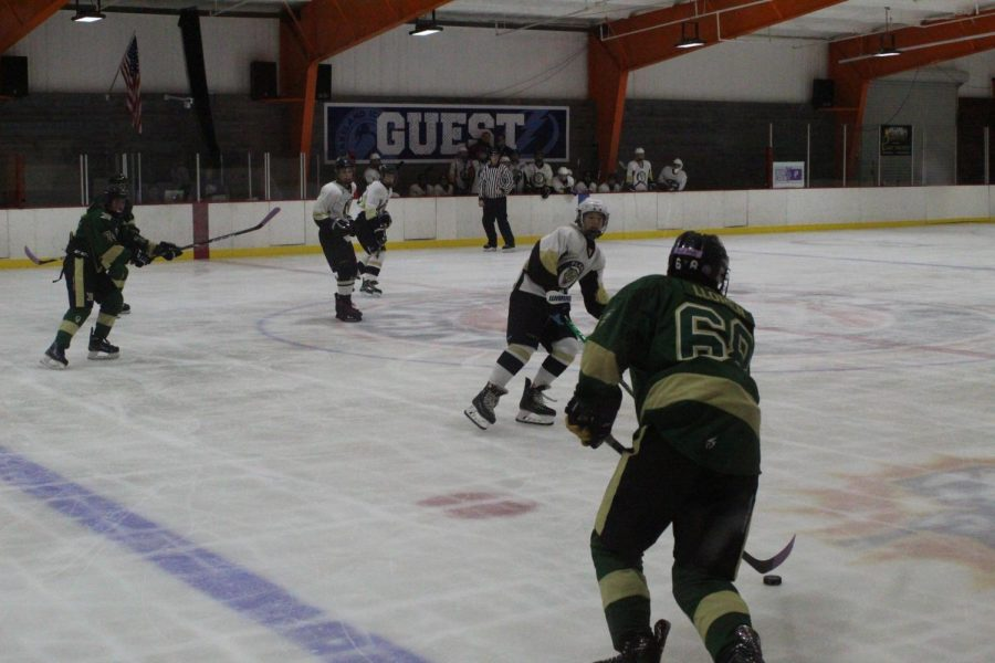 Leaning back, freshman Brenden Sickles moves parallel to an opponent. Sickles plays as a forward and scored his first official goal at the game against Mitchell.
