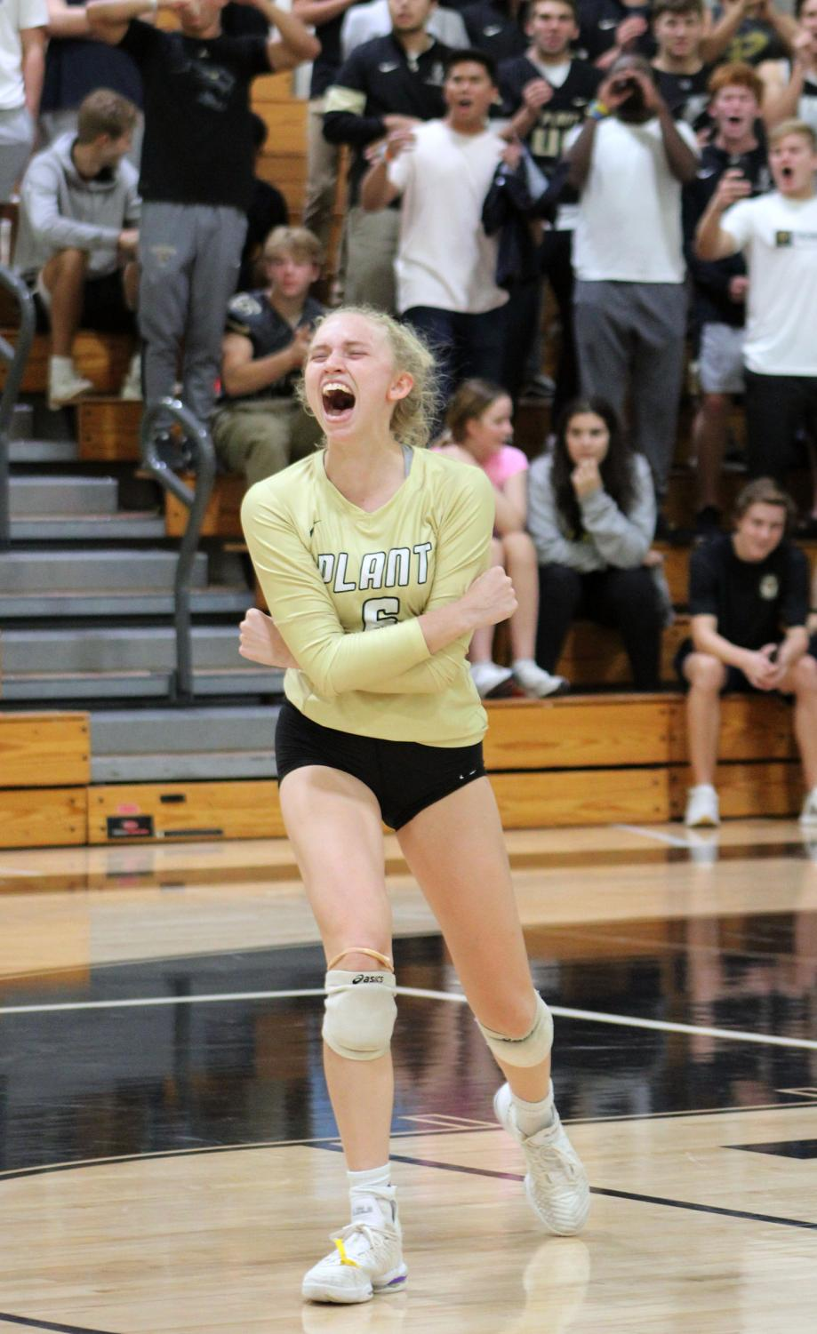 Shouting out, senior Birdie Frierson celebrates after a score. Frierson played outside hitter for the varsity volleyball team during their 2019 season.