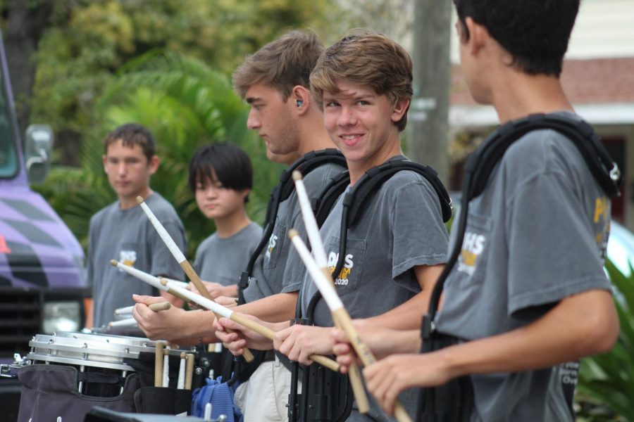 Smiling as he plays, senior J.T. Hill performs at the End 68 Hours of Hunger event Nov. 4 at Hyde Park Presbyterian Church. The Tampa Bay Chapter of this organization feeds 535 kids weekly on weekends when school lunches are not available.