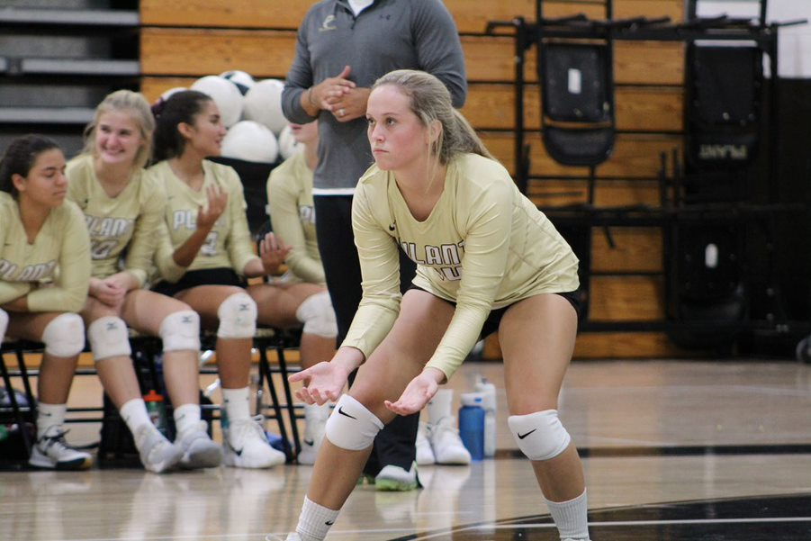 Getting in position senior Adele Cassidy, plays as a libero, defensive specialist. Adele has been playing volleyball for four years .