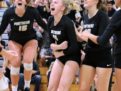 Jumping in the air, sophomore Reese Friar and seniors Elizabeth Price and Birdie Frierson celebrate after a score. The victory against Windermere meant the team won regional semi-finals.