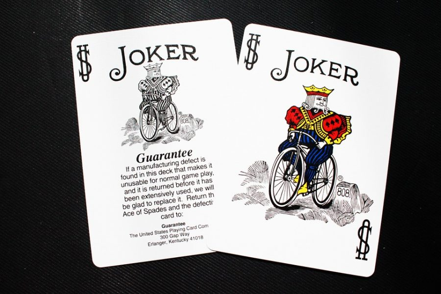 The Joker card from a classic 52 deck symbolizes the Joker's calling card. Released on Oct. 4, the Joker is set to surpass 1 billion dollars.