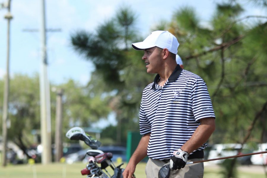 Grabbing his bag, sophomore Matthew Lorenzo gets ready to move. Lorenzo started playing golf when he was 3 years old.