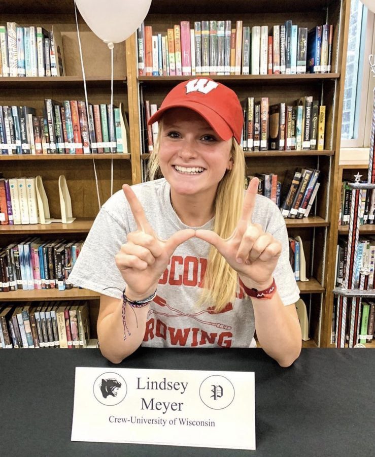 "Committing to Wisconsin University, senior Lindsay Meyer holds up a ""W"" to represent her commitment and devotion. Meyer was on the crew team as a coxswain."