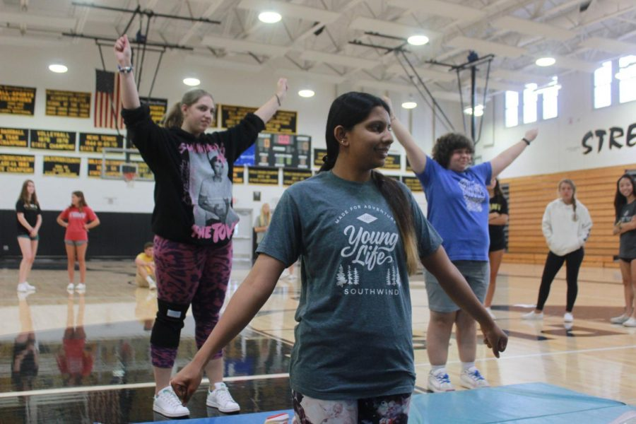 Striking a pose, senior Aarushi Pratap, juniors Addie Lennon and Emma Jones rehearse their routine during cheer practice. The Special Olympics cheer team will compete in the summer games April 2020 at the ESPN Wide World of Sports center in Orlando.