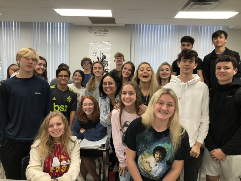 During fourth period, Spanish teacher Yohanis Carrera poses for a picture with her students at the start of class. Carrera said she showed her appreciation for her students by having a class party.