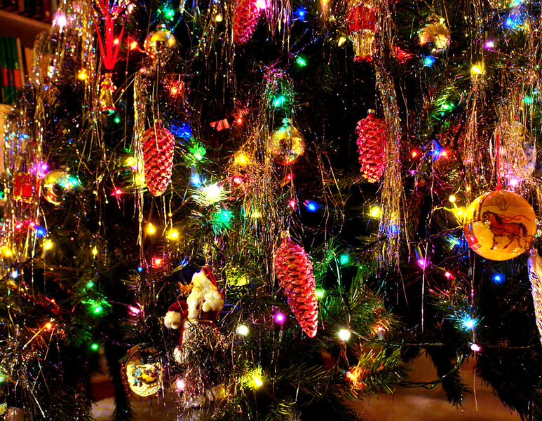 Artificial Christmas trees are easier to decorate than real trees because most trees are sold with lights pre-strung throughout the tree. This feature eliminates the hassle of stringing lights and guarantees that they will be evenly distributed throughout the branches. Photo courtesy of Wikimedia Commons.