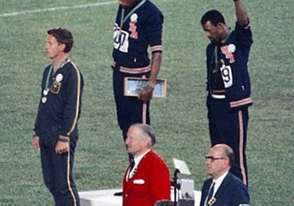 Fists raised in protest, sprinters Tommie Smith and John Carlos engage in among the most famous Olympic protests in history during the 1968 Mexico City games. The International Olympic Committee's recent statement that banned protests for the upcoming Tokyo games both silences athletes and disregards the history of the games.  Photo courtesy of Wikimedia Commons.