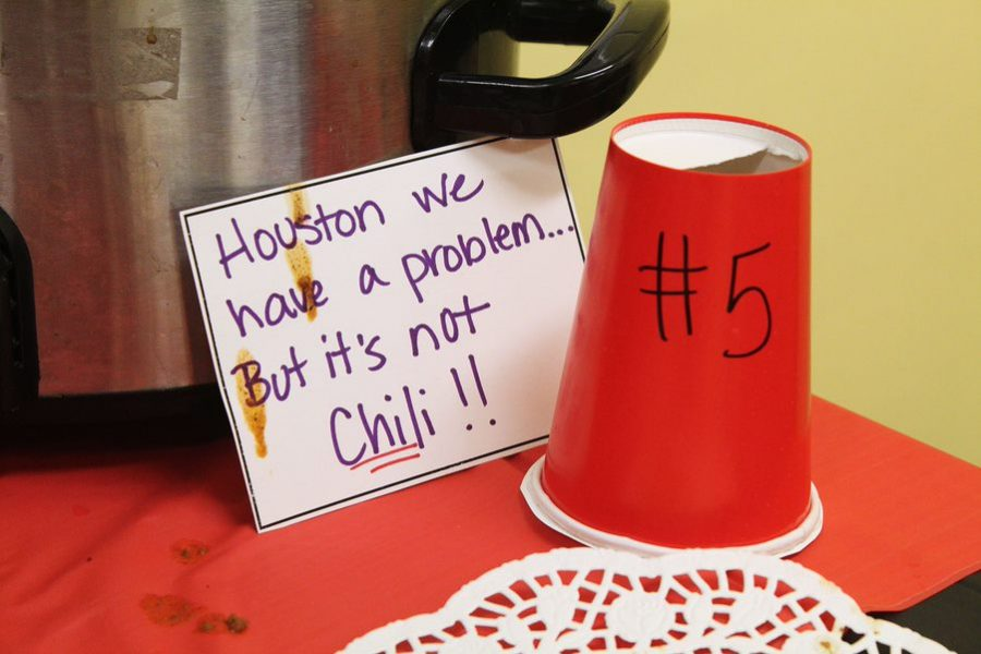 "Serving as a label, AVID teacher Valerie Houston's sign provides an example for the many puns incorporated into the chili displays. Other labels included Puckett's ""Hotter Than a Classroom in Hillsborough County,"" and ""Chili-ish Gambino."""