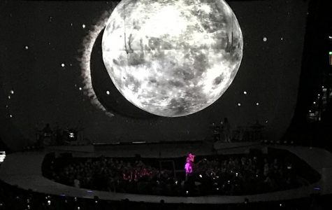 """Singing her song Moonlight from the """"Dangerous Women"""" album, Ariana Grande performs at Amalie Arena. Grande had to cancel the original concert due to coming down with a illness hours before show."""