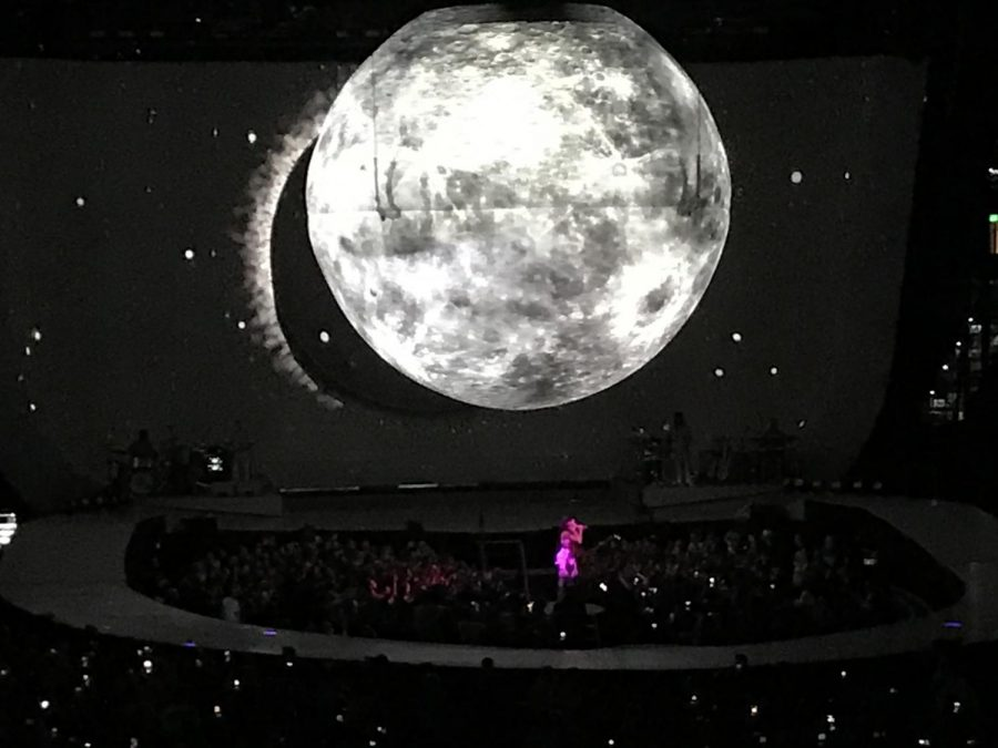 "Singing her song Moonlight from the ""Dangerous Women"" album, Ariana Grande performs at Amalie Arena. Grande had to cancel the original concert due to coming down with a illness hours before show."