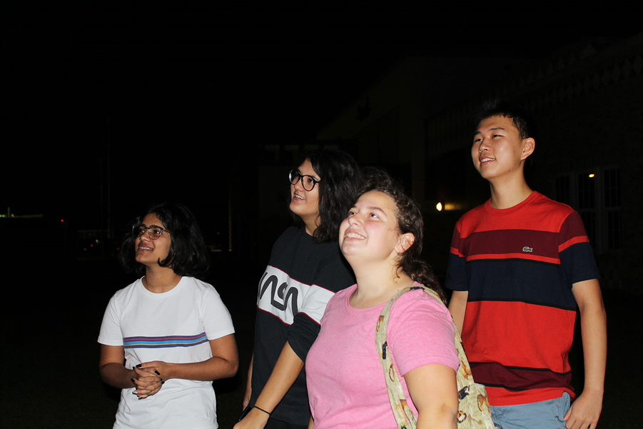 Looking at the stars, seniors Julie Elorza and Eric Zhao, junior Shibani Rana, and sophomore Julie Cortez gather to discuss the results from meeting, Oct. 23, outside the new building. This was the astronomy clubs first meeting of the year.