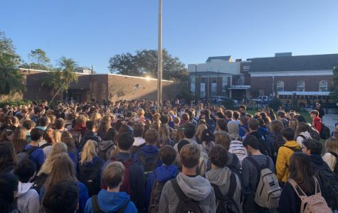 Gathered around the flagpole, students and faculty alike come together in prayer to mourn the loss of Carlos Medina. Medina died Monday, Jan. 20 after being in critical condition following a car accident. Medina was a junior and was on the Plant swim team.