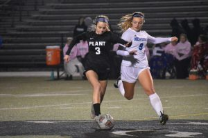 Doing it for kicks: girls soccer
