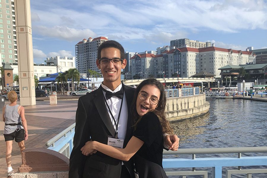 Hugging each other, senior Eve Larkin and sophomore William Mathangani stand outside the Tampa convention center. Larkin placed 12th chair for first violin at all state and Mathangani placed eighth chair for viola.