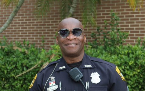 Posing for the camera, school resource officer Mark Holloway smiles on his last day at Plant. Officer Holloway has been at Plant for 11 years and officially retired from his position Friday, Jan. 24.