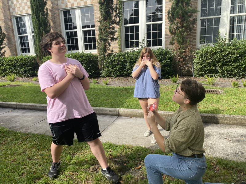 Proposing to senior Graham Hill, senior Alexis Perno holds up fun dip. Valentine's Day does not need to be celebrated with significant others as shown in the picture.