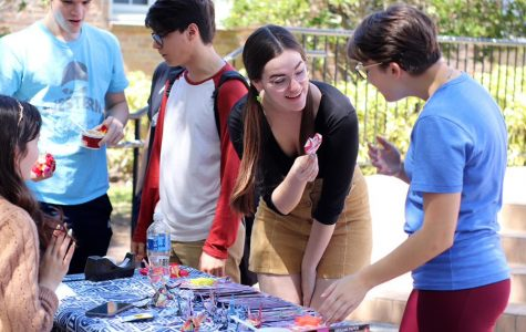 Showing off their creations, students create crafts at the anime club table. This year was the first time the club participated in Spring Fling.