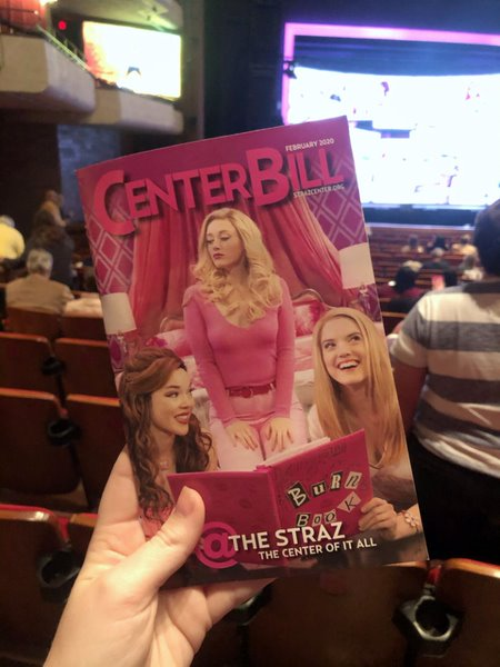 Before each Broadway show, the ushers hand out Playbills that contain the song list and cast biographies for the audiences to read. The cover is a photo of the Plastics, Gretchen, Regin, and Karen, reading the Burn Book.