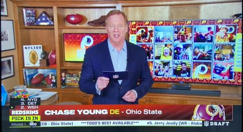 Holding a draft card, NFL Commissioner Roger Goodell announces defensive end Chase Young as the Washington Redskins pick. The NFL held a virtual draft due to Coronavirus concerns.