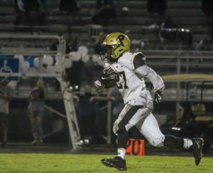 Running down the field, return man EJ Crawford prepares to escape the defenders. The varsity football team will face Sickles High School on Friday, Sept. 25.