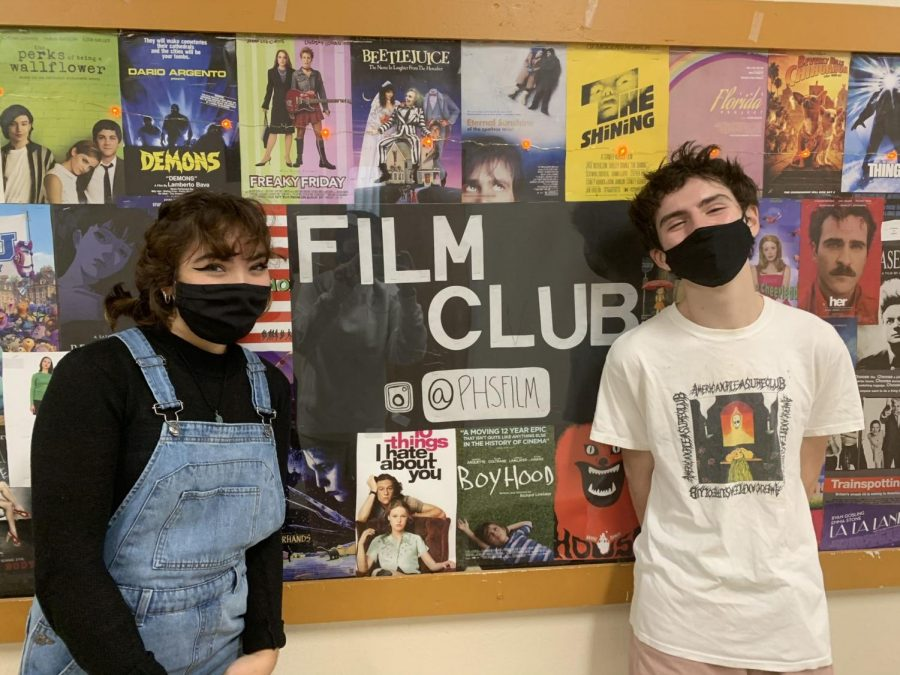 Standing+next+to+the+film+club+board+in+main+hall%2C+co-presidents+Alexa+Semmelmann+and+Owen+Felton+talk+about+their+time+with+the+film+club.+Film+club+consists+of+monthly+meetings+to+talk+about+influential+films.
