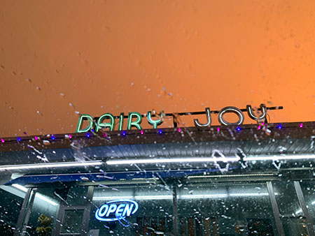 The electric Dairy Joy sign lights up during a summer storm last June. Dairy Joy is one of numerous great places to get ice cream in South Tampa.