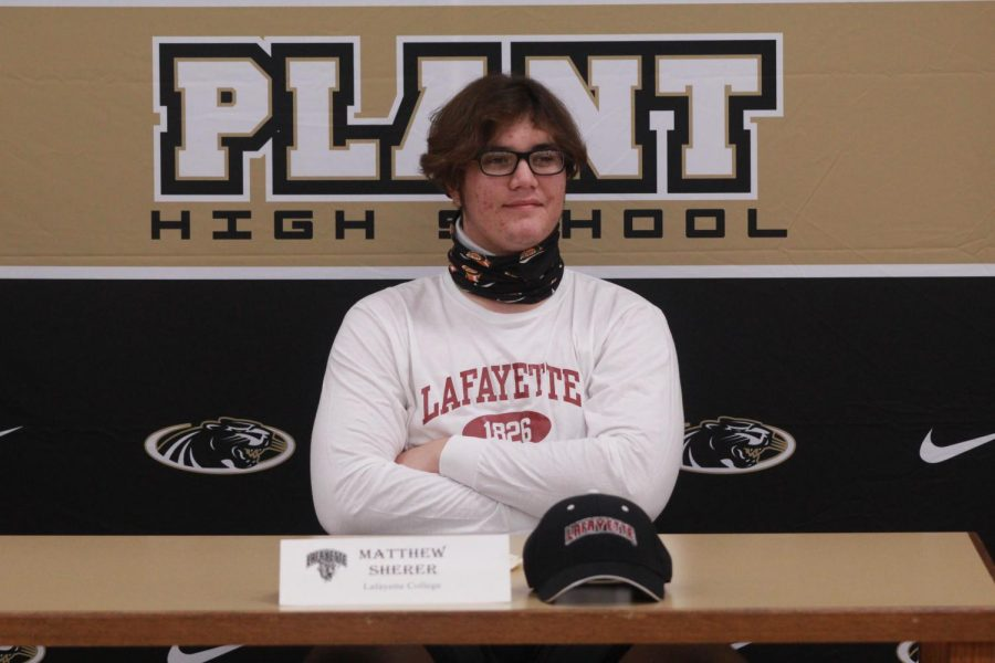 Looking+out+at+his+friends+and+family%2C+senior+Matthew+Sherer+prepares+to+sign+his+letter+of+intent.+Sherer+will+be+attending+Lafayette+College+next+fall.