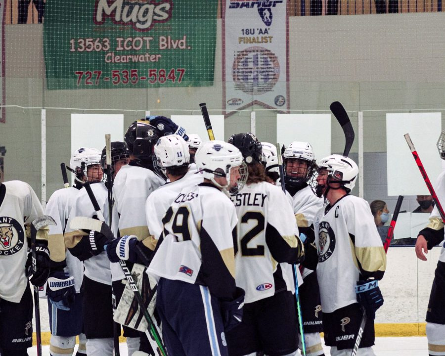 Huddling+close+and+hitting+each+other%27s+helmets%2C+the+Plant+team+congratulates+each+other+for+another+win+this+season.+The+hockey+team+beat+Palm+Harbor+in+the+Clearwater+Ice+Arena.++