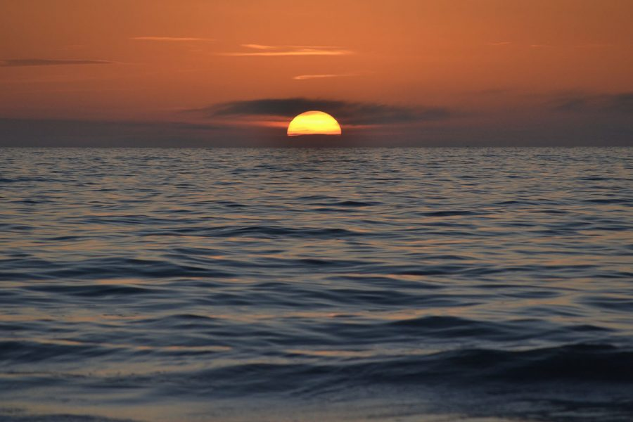 The sun sets over the water in Pass-A-Grille Beach, Florida. Pass-A-Grille is only a 40-minute drive away from Tampa.