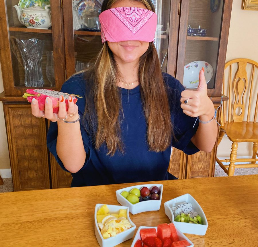 Trying fruits for the first time, senior Lauren Azevedo is blindfolded. Azevedo doesn't like fruits because of their texture.
