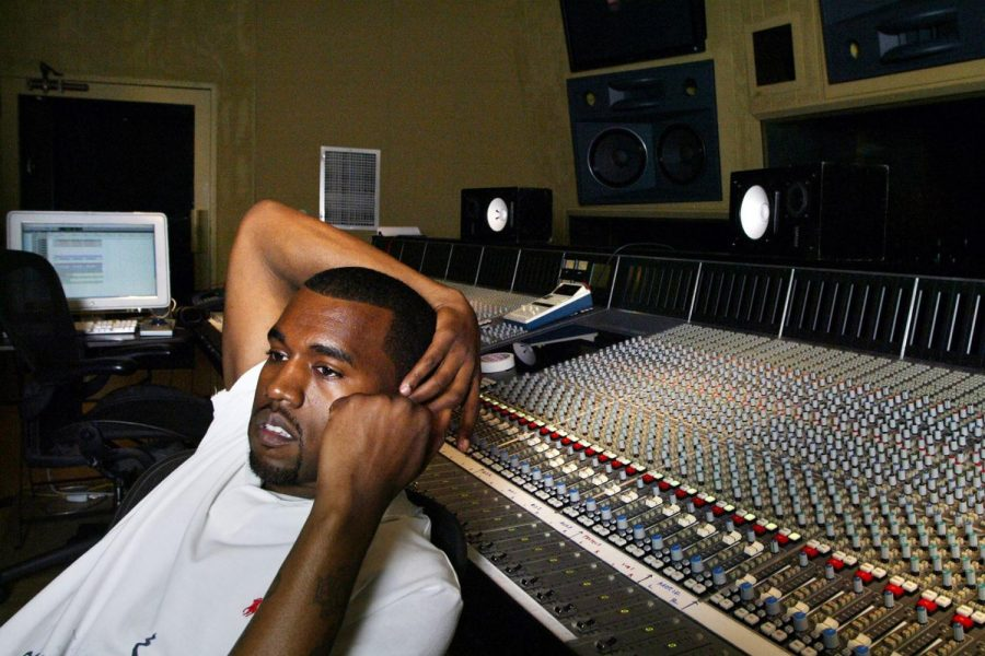"Sitting in the studio with an arm above his head, Kanye West looks in the distance. West has made many albums including, ""My Beautiful Dark Twisted Fantasy"", ""Ye"", ""Life of Pablo"" and more. Image courtesy of Rolling Stone."
