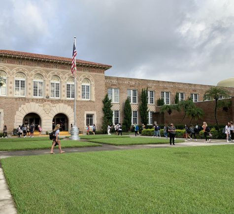Students walk around campus during the first day of in-person school in August 2020. Last school year was characterized by constantly changing COVID mitigation policies.