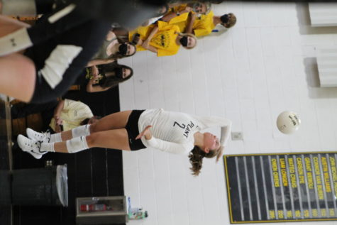 Setting the ball, senior Lily Frierson hits the ball across the net. Plant won against Calvary 3-0 on Sept. 9.