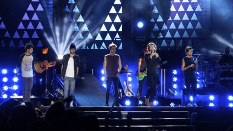The band One Direction performs on stage in front of thousands of fans. Millions of people around the world are still waiting for their return.