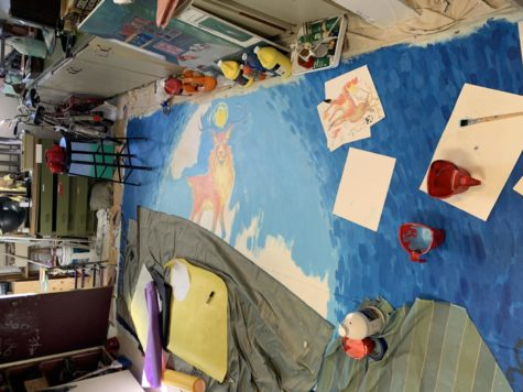 On the floor, a mural that Hannah Hanstead and her art club friends have been working on. Hanstead has been drawing since she was 12.