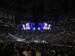 """Harry Styles is singing his song """"Falling"""" to an arena packed with thousands of fans. Love On Tour is Harry's second solo tour and will continue until Nov. 24."""